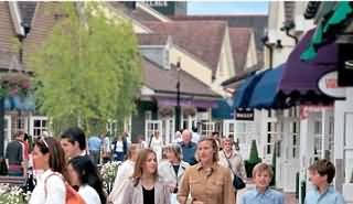 "Bicester is probably best known for its modern ""Bicester Village"" shopping outlet"