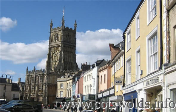 Cirencester main shopping street with Church of St. John in background
