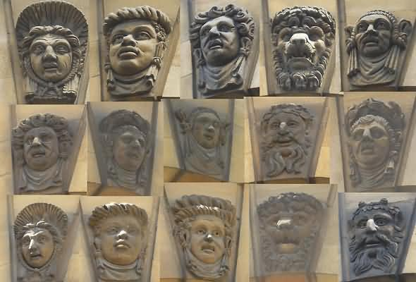 Carved stone heads above the external windows of the Sheldonian Theatre