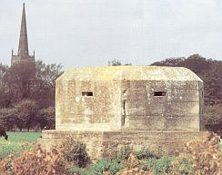 A defensive Pill-Box on the side of the River Thames