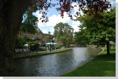 River Windrush flowing through the Cotswolds village of Bourton-on-the-Water